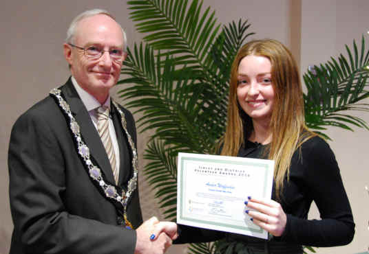 Amber receiving her certificate from Ilkley Town Mayor, Cllr. Steven Butler